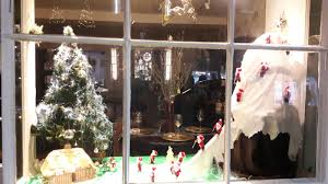 ski ing santas in chestnut tree house charity shop festive window