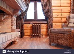 interior a chimney hall in a wooden house with a cast