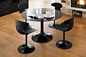 black glass kitchen table black glass round dining table with tulip chairs for modern dining