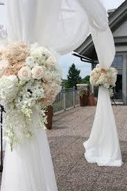 wedding altar flowers altar flower arrangements chagne and white wedding altar