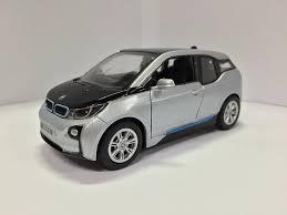 bmw 3i electric car amazon com set of 4 1 32 scale bmw i3 electric car model orange