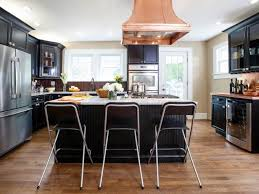 white kitchen with black island black kitchens are the white hgtv s decorating design