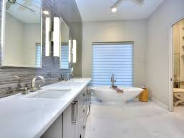 photos by design custom home concierge hgtv stylish contemporary bathroom with gray stone accent wall marble floor