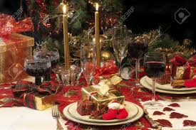 traditional christmas table setting with tree presents candles