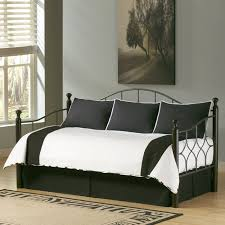 black and white bedding set on black polished iron daybed frame in