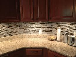 reddish brown wooden kitchen cabinet glossy granite countertop