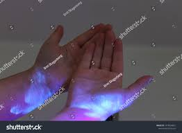 can a black light detect closeup hands under black light detect stock photo edit now
