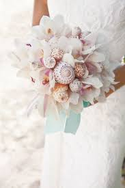 wedding bouquets with seashells loving these shell bouquets seashells wedding pin