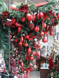 christmas trees decorated with red ribbon ne wall