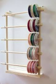 Organize Gift Wrap - great idea for organizing wrapping papers spools of ribbon