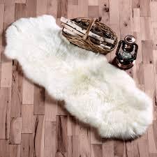White Sheepskin Rugs Flooring Exciting Pergo Flooring With White Sheepskin Rug And