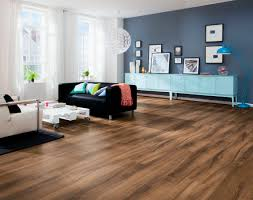 decor laminate flooring with black loveseat and grey wall for