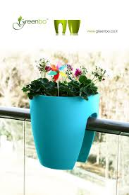 modern sleek saddle planter for balconies and railings indoors