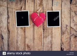 red heart and two photo frame hanging on clothesline with