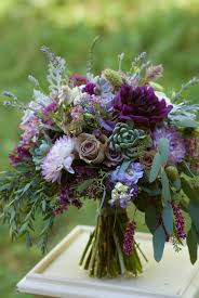 plum and lavender bridal bouquet featuring dahlias roses