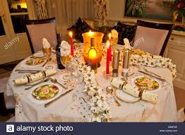 christmas dinner table setting at night stock photo royalty free