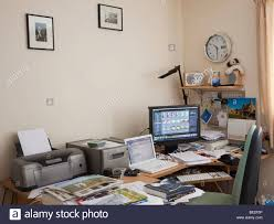 Laptop And Printer Desk by Photographers Office At Home With Laptop Monitor Displaying Stock