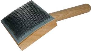 curved carding comb