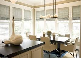 Sun Blocking Window Treatments - cream colored dining room with roman shades for sunblocking