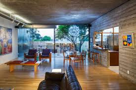 glass sliding doors open plan living dining space urban house