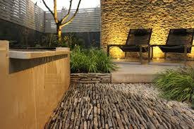 contemporary landscaping backyard landscaping ideas dense greenery complemented by a rock