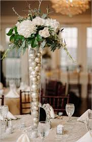 picture of glass vases filled with ornaments and topped with