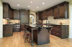 mahogany wood orange zest raised door dark cabinets kitchen