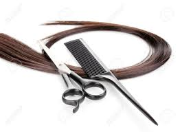 shiny brown hair with hair cutting shears and comb isolated on