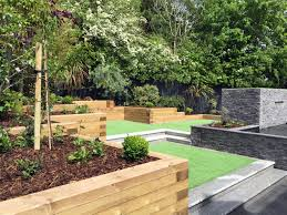 modern sloping garden with feature koi pond lush design plus carp