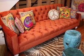 reiko design blog burnt orange sofa room service store