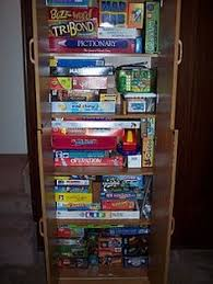 board game storage cabinet organized entryways and repurposed dressers house organization 2
