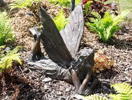 laying bronze look garden ornament co uk garden