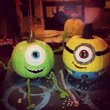 mike wazowski and minion painted pumpkins the illuminati is