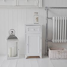 White Wooden Bathroom Furniture A Crisp White Freestanding Bathroom Storage Furniture A Narrow