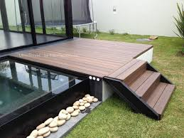 floor dark wood interlocking deck tiles with front wood steps and