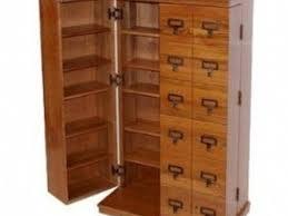 oak finish storage cabinet 37 cd and dvd storage cabinet with doors oak finish leslie dame