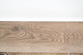 Laminate Or Real Wood Flooring Our Flooring Solid Wood Vs Faux Wood Tile Chris Loves Julia