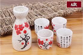 saké de cuisine vintage ceramic sake pot and cups set with characters poem