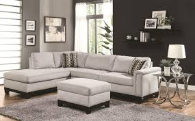 light gray sectional sofa with black stained wooden based legs