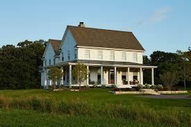 two farmhouse porch gable exterior farmhouse with grass traditional chickadee
