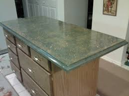 green marble countertop on brown wooden cabinet with drawer on