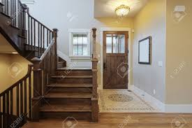 elegant home foyer with wood stairs and flooring stock photo