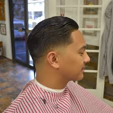 styled shear haircut with a low bald fade and razor lineup by