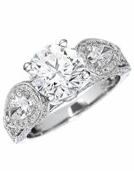 brilliant engagement rings images Round brilliant with pear shaped side stones engagement rings jpg