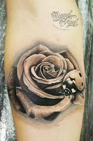 black and grey 3d ladybird on rose tattoo on forearm jpg 680 1024
