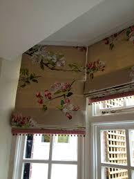 i love this fabric on these trimmed roman blinds in a bay window