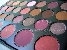 26 colour eyeshadow and blush palette swatches of faces and fingers