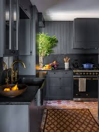 gray kitchen cabinets with black appliances how black became the kitchen s it color architectural digest