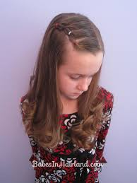 bang pull back puffy braids on the side great if you u0027re growing