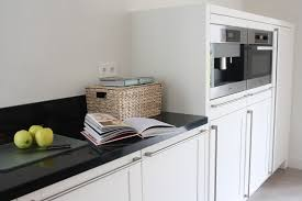 white sink black countertop modern kitchen cabinet kitchen traditional with apron sink black